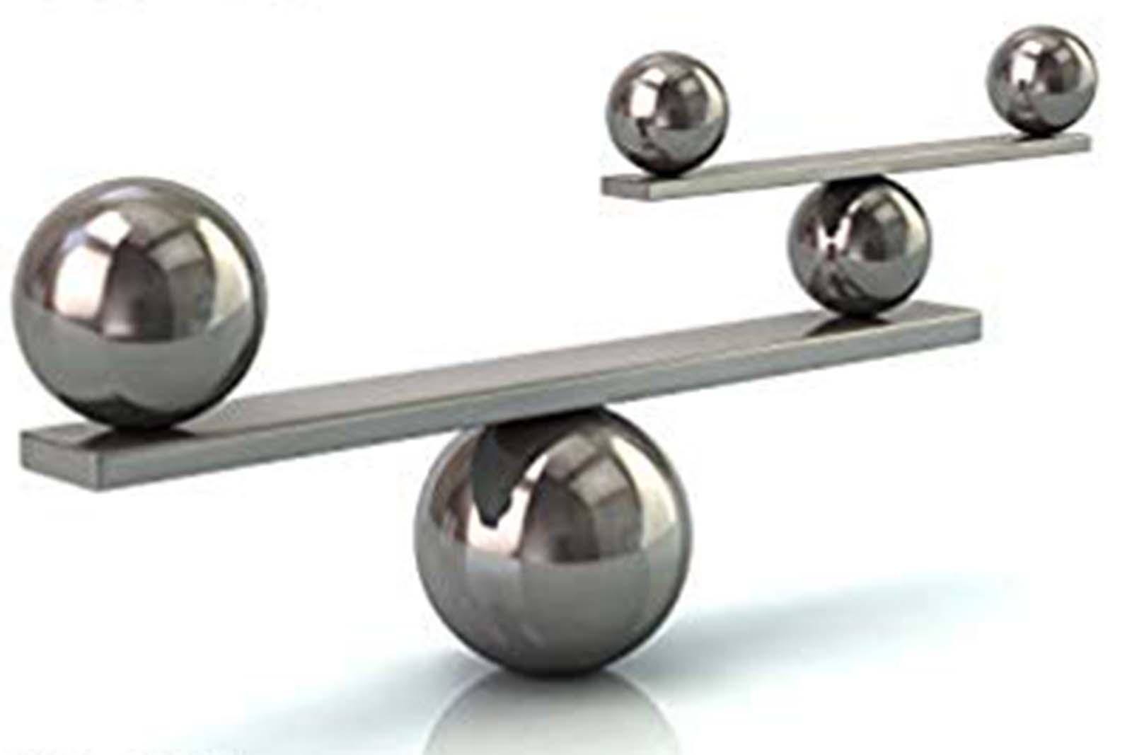 Photo of metal balls balancing on metal rods